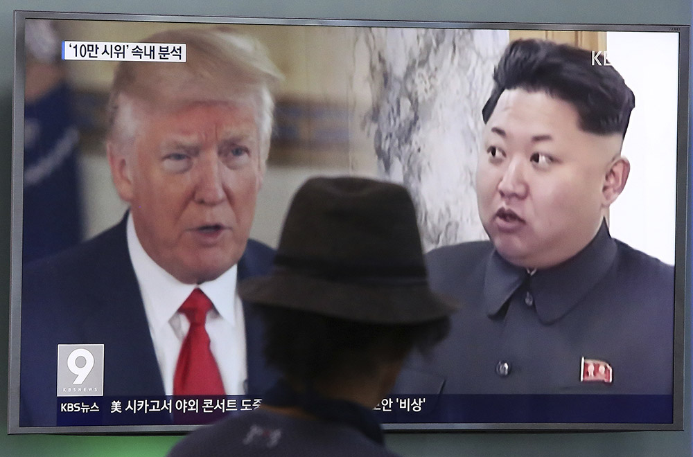 A television screen in Seoul, South Korea, shows President Trump and North Korean leader Kim Jong Un during a news program in August. South Korea's national security director said Thursday that the two will meet