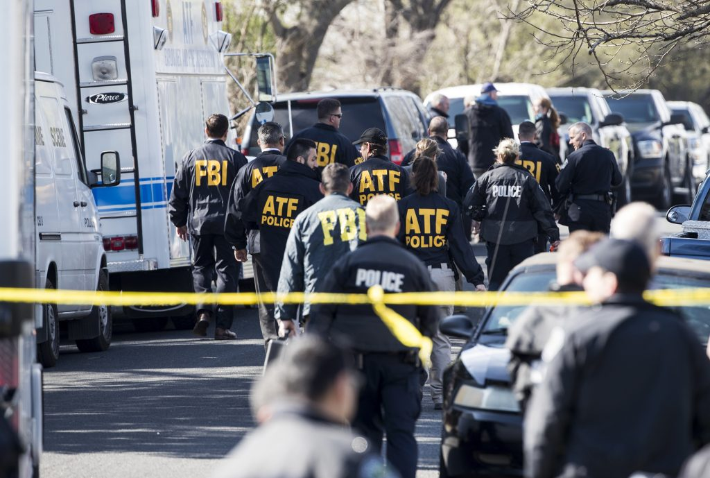 Authorities work on the scene after multiple explosions in Austin on Monday. Police are responding to another explosion Monday, that badly injured a woman, hours after a package bomb killed a teenager and wounded a woman in a different part of the city.