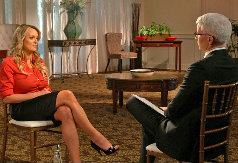 "This image released by CBS News shows Stormy Daniels during an interview with Anderson Cooper that will air Sunday night on ""60 Minutes."""