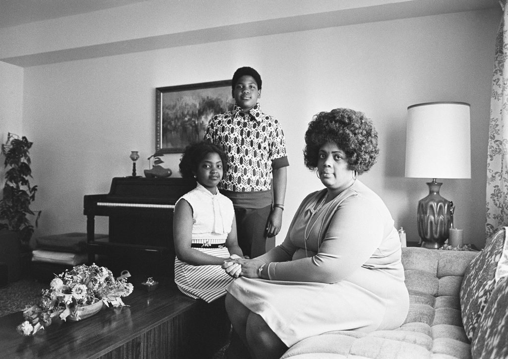 In this April 30, 1974, photo, Linda Brown, right, and her two children pose for a photo in their home in Topeka, Kan. Brown, the Kansas girl at the center of the 1954 U.S. Supreme Court ruling that struck down racial segregation in schools, has died at age 75. Peaceful Rest Funeral Chapel of Topeka confirmed that Linda Brown died Sunday.