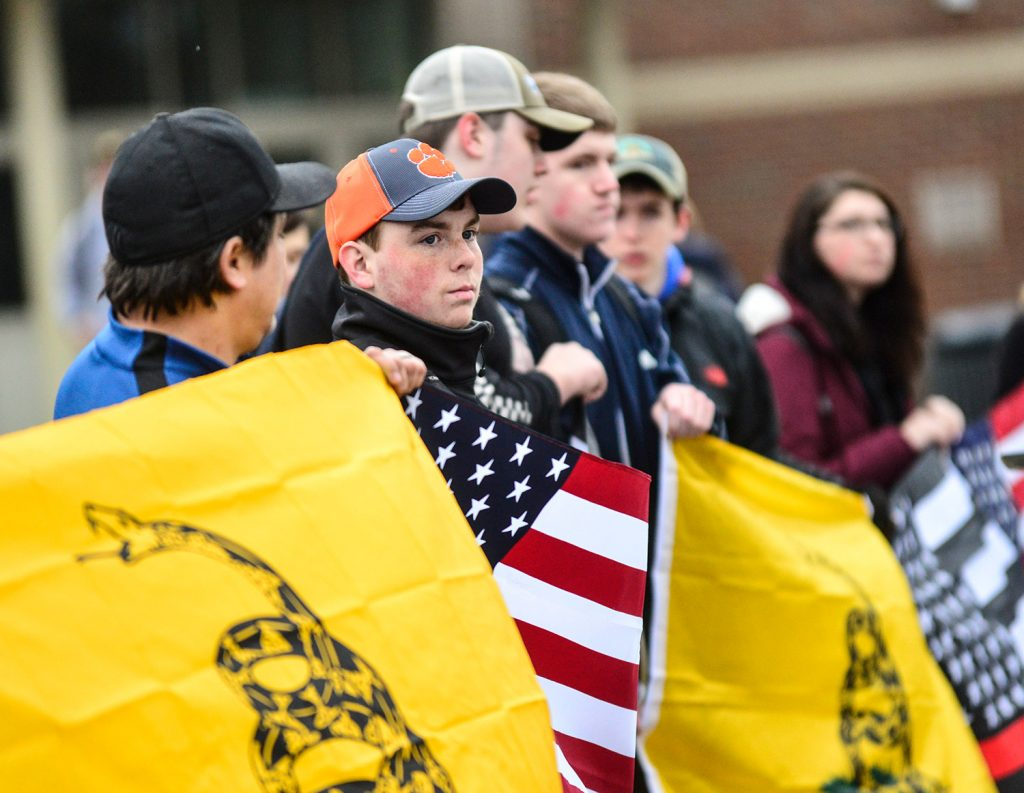More than two dozen students and citizens gather outside Brattleboro Union High School in Brattleboro, Vermont, on Friday before the start of classes to hold a rally in support of the Second Amendment and gun rights. The Vermont Legislature approved new gun restrictions Friday.