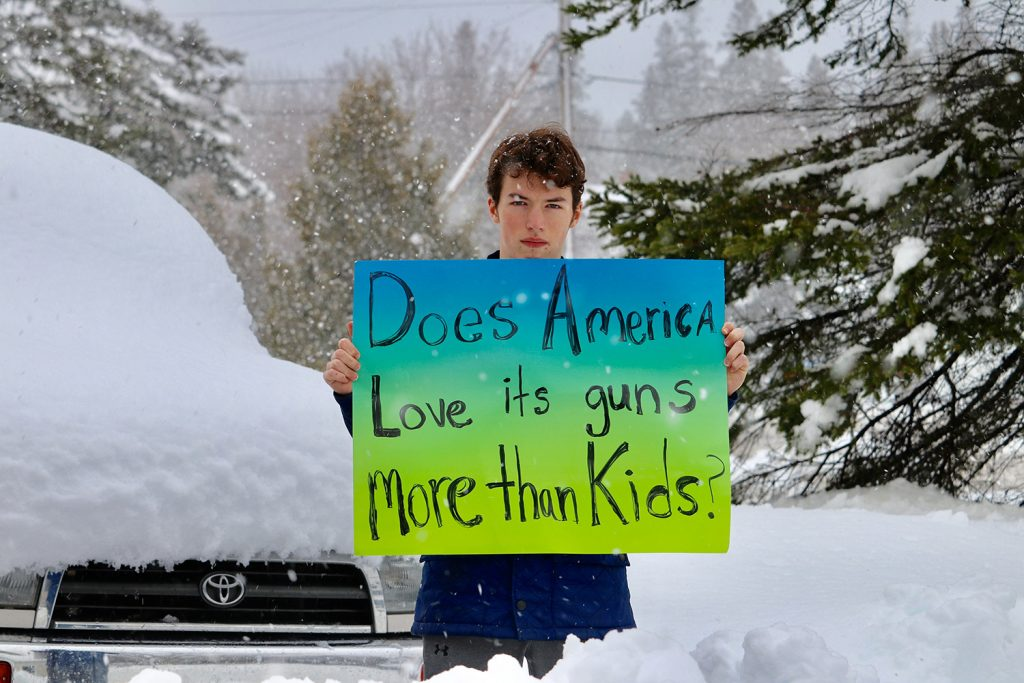 Finian Burns, a freshman at Mount Desert High School, joins a student protest against gun violence on Wednesday. The Bar Harbor school was among those in Maine whose students staged a protest even though school had been canceled for the day because of a snowstorm.