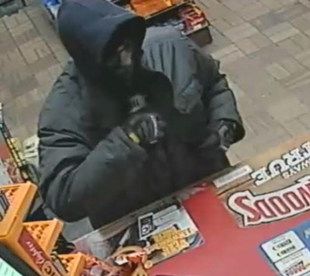 The man who robbed the Riverton Gas Station in Portland on Tuesday night, shown in a security camera image, was described as white and about 30 years old. He is about 5-feet-5-inches tall with a thin build. He was wearing a heavy dark jacket, dark cap, dark gloves and a half-face ski mask.
