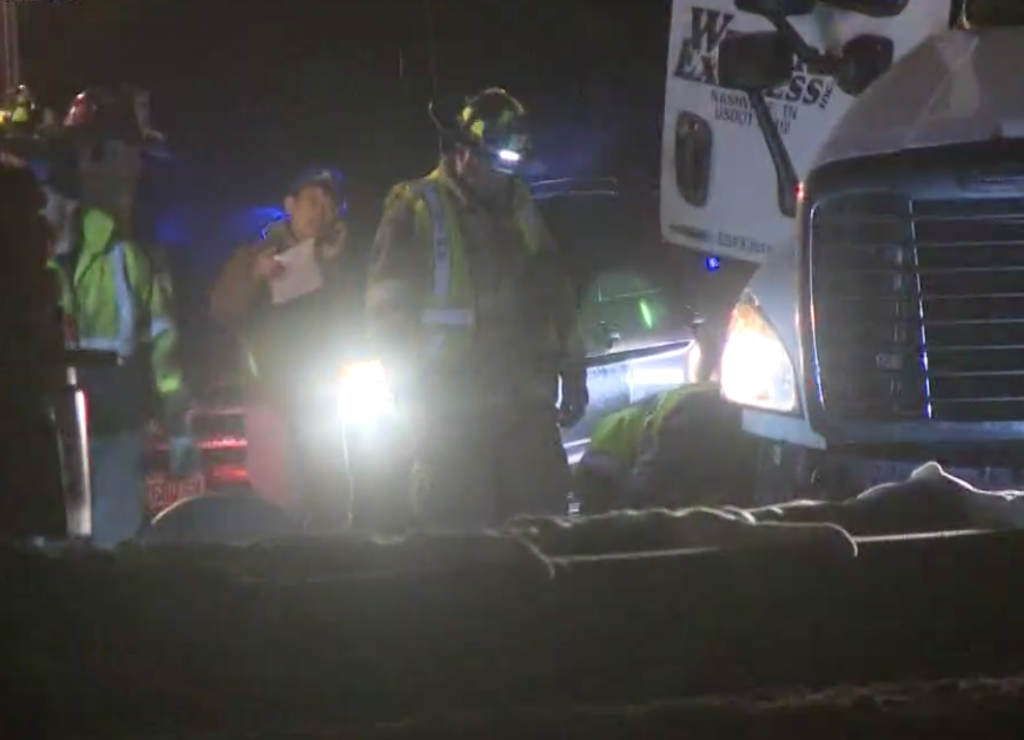 First responders work Thursday night at the scene of the crash on the Maine Turnpike.