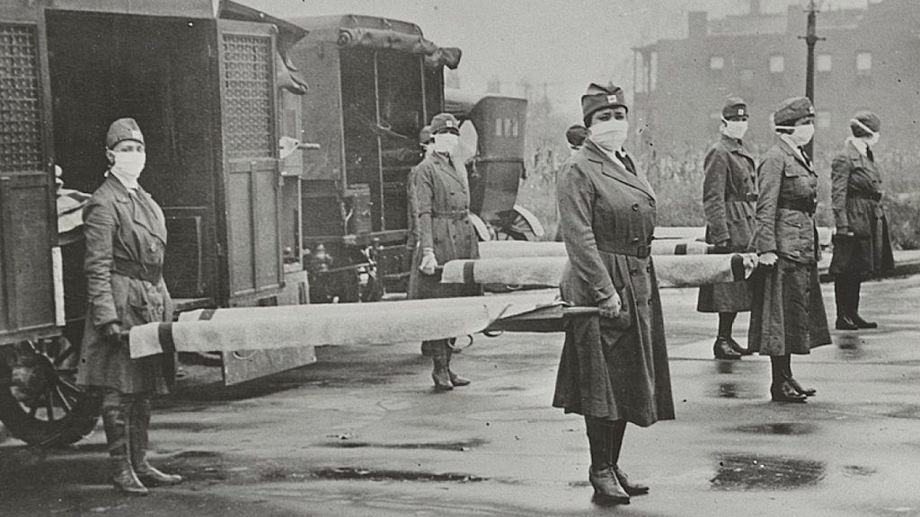 St. Louis Red Cross Motor Corps personnel prepare to transport victims of the 1918 influenza epidemic.