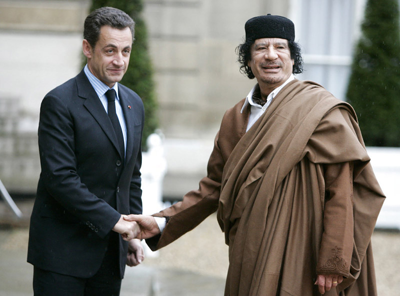 French President Nicolas Sarkozy greets Libyan leader Col. Moammar Gadhafi upon his arrival at the Elysee Palace, in Paris, in December 2007.