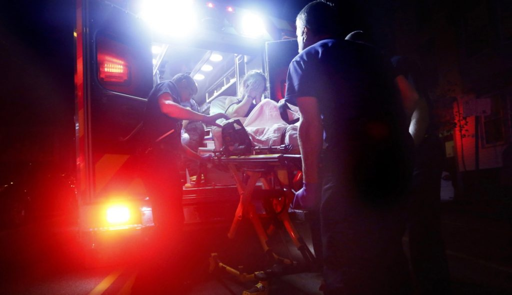 Portland paramedics use naloxone to revive a woman after a report of a heroin overdose on Congress Street in 2015. The number of overdose deaths is still on the rise in Maine, six years into the epidemic.