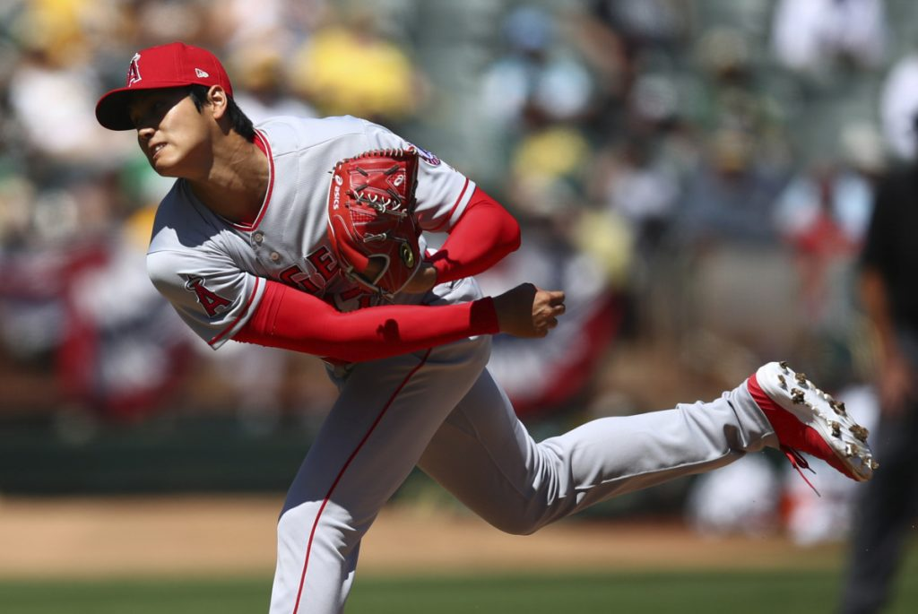 Shohei Ohtani of the Angels delivers a pitch Sunday in his first major league start on the mound, against the Athletics. Ohtani got the win, allowing three hits and three runs in six innings.