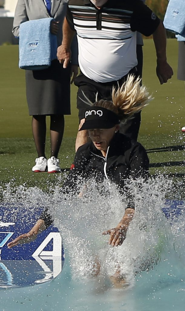 Pernilla Lindberg takes the traditional winner's jump into Poppie's Pond after her victory Monday in the ANA Inspiration.