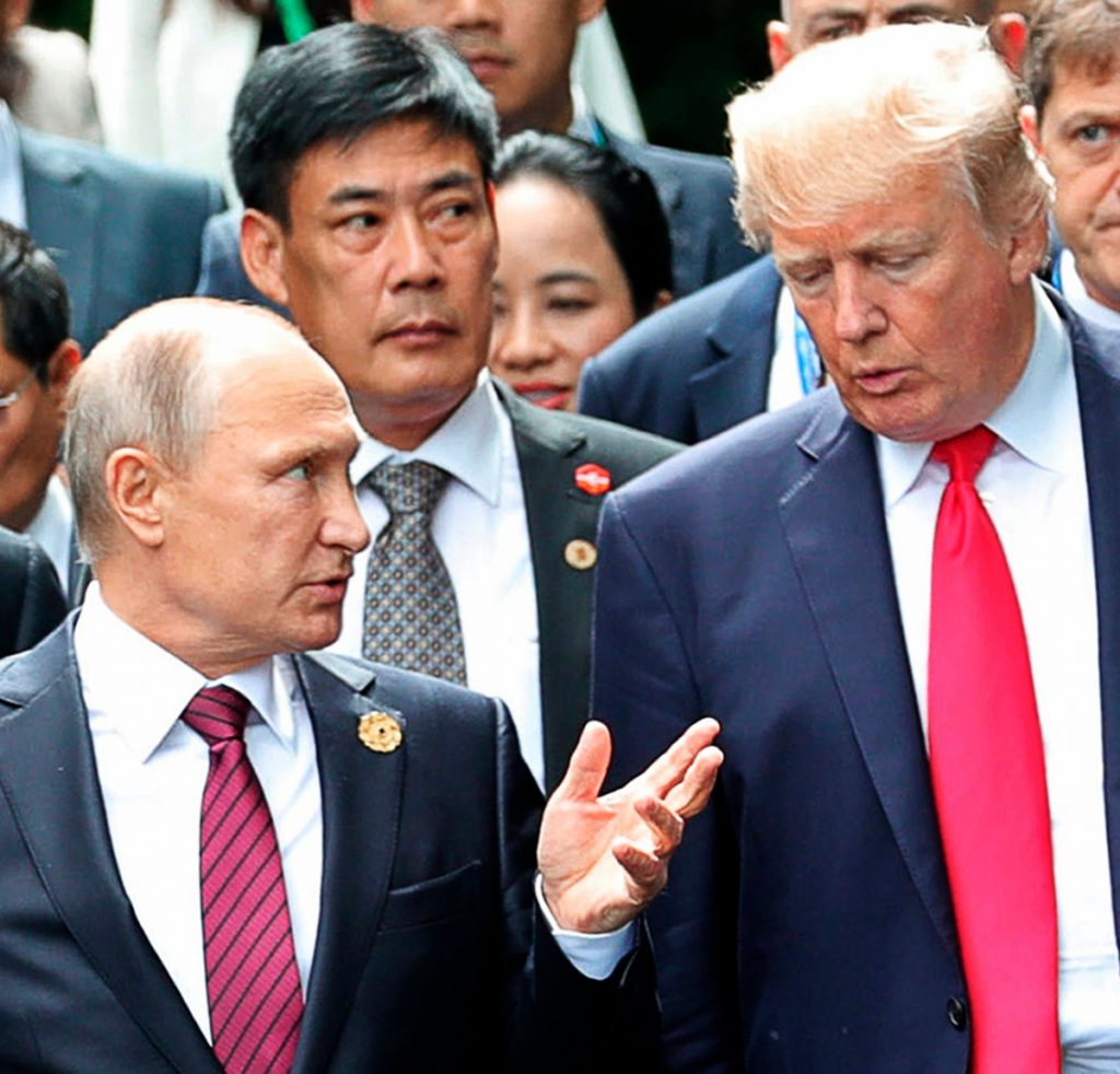 President Trump and Russian President Vladimir Putin talk at the APEC Summit last November. Trump is opening the door to a potential White House meeting with Putin.