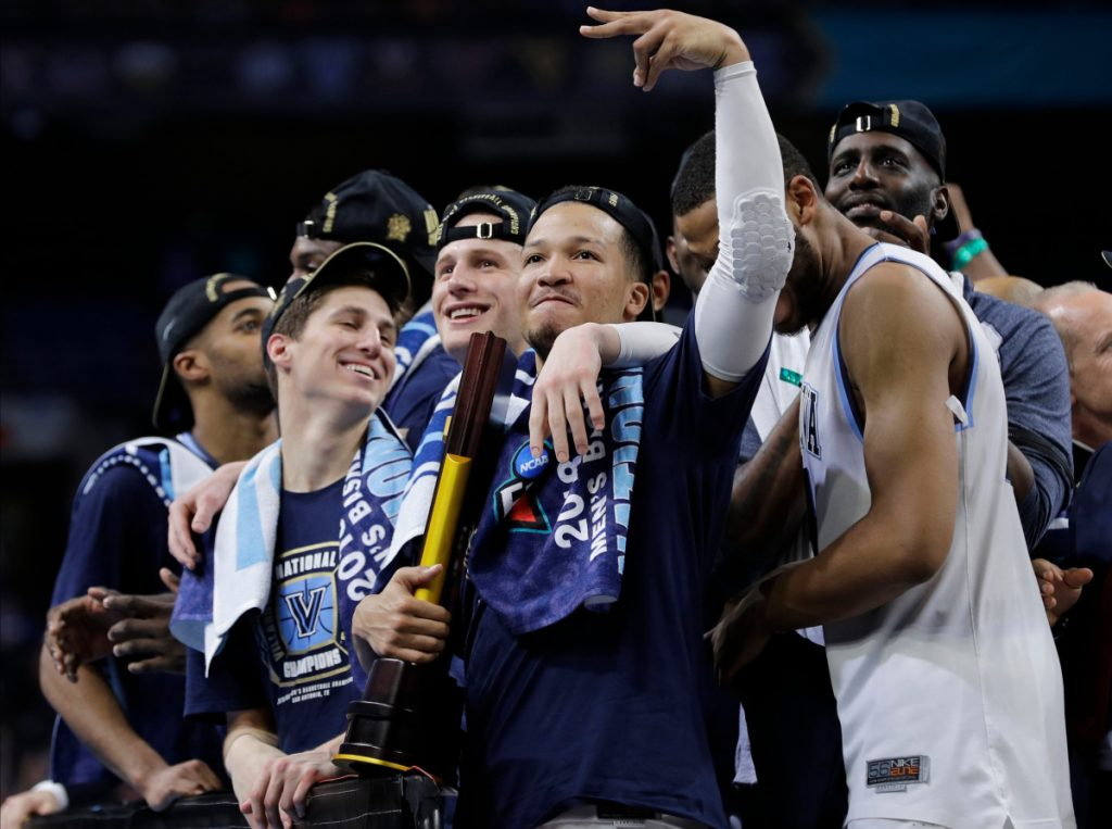 Villanova players celebrate after Monday night's title win over Michigan. The Wildcats won all six tournament games by double digits, last done by North Carolina in 2009.
