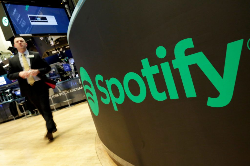 A trading post sports the Spotify logo on the floor of the New York Stock Exchange. Spotify is the No. 1 music streaming service, and its success has drawn comparisons to the Netflix video service.