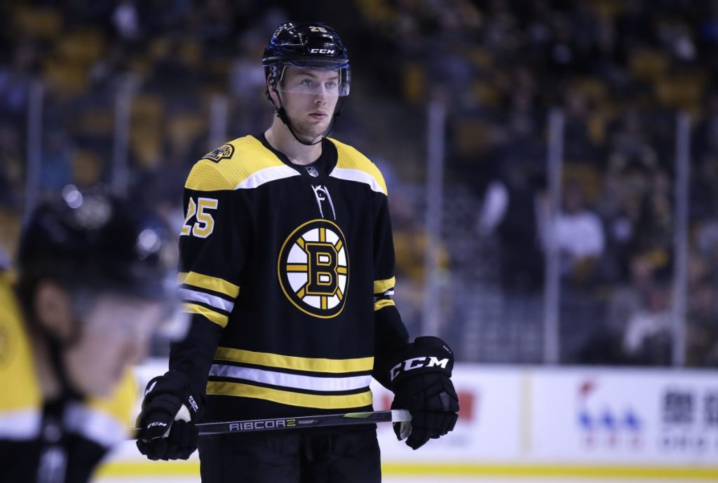 Boston Bruins defenseman Brandon Carlo will miss the rest of the season with a broken ankle.