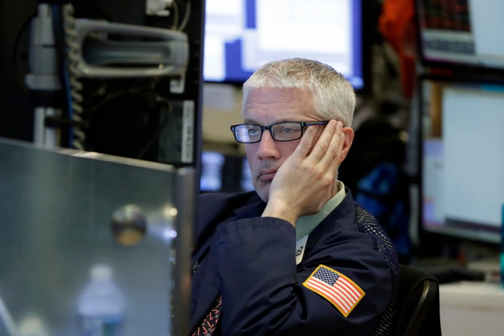 Trader Mark Zifchak works on the floor of the New York Stock Exchange on Wednesday. The quick daily swings that now seem commonplace can make things dicey for investors trying to time their trades.
