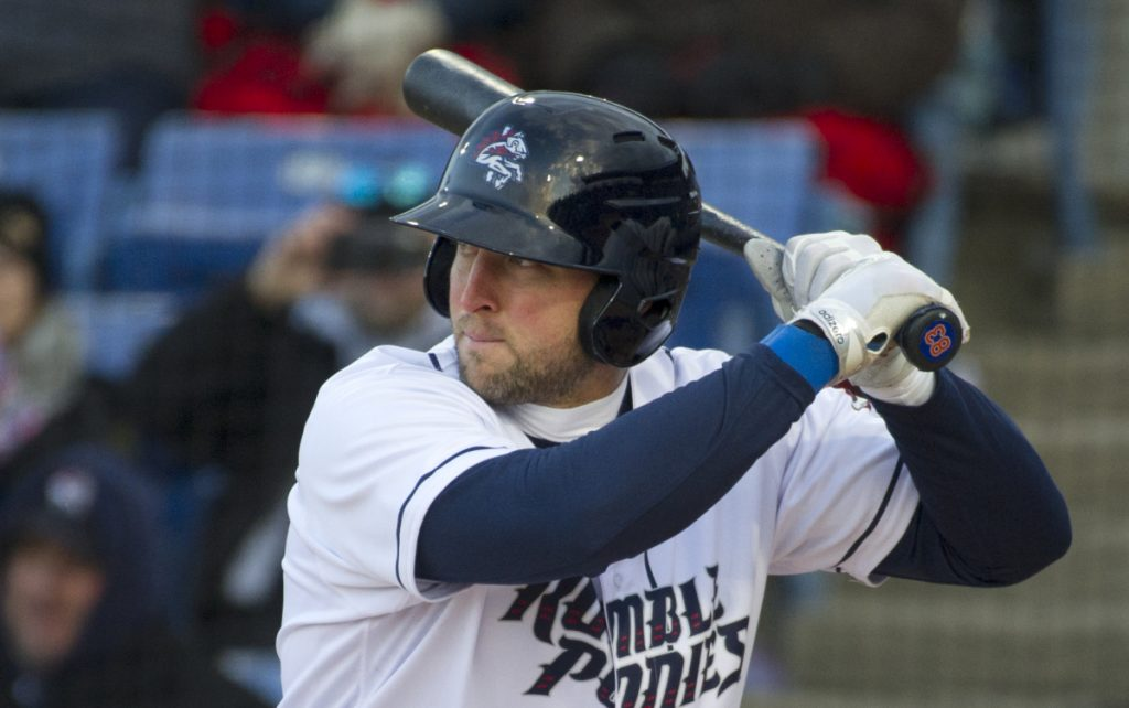 Tim Tebow, playing for the Binghamton Rumble Ponies, prepares to bat in the first inning against the Portland Sea Dogs in a season-opening game on Thursday in Binghamton, N.Y. Tebow homered on the first pitch he faced.