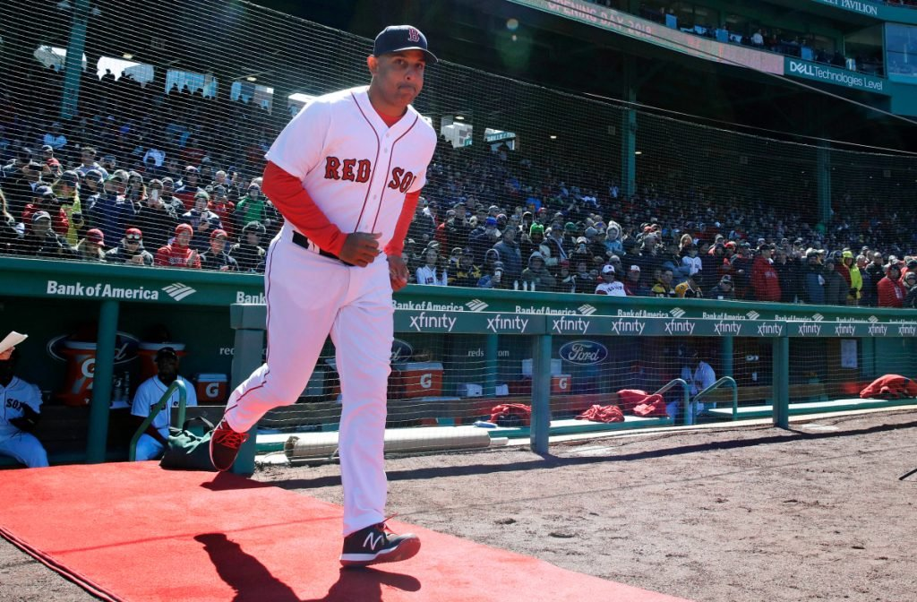 Boston Red Sox Manager Alex Cora runs onto the field as he is introduced during ceremonies before Thursday's home opener against the Tampa Bay Rays at Fenway Park in Boston.