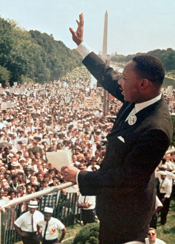 "The Rev. Martin Luther King Jr. acknowledges the crowd at the Lincoln Memorial for his ""I Have a Dream"" speech during the March on Washington on Aug. 28, 1963."