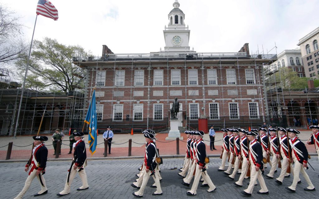 A regiment marches past Independence Hall in opening ceremonies for the Museum of the American Revolution in Philadelphia. The museum includes the previously untold roles played by Native Americans, blacks and women.
