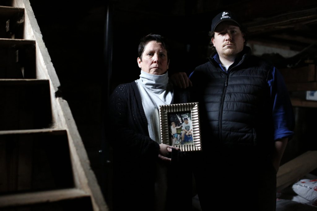 At their Gorham home, Faith Joyal and Marc Joyal-Myers hold the memories of their lost son and brother and still hunger for answers about who killed him in the Denny's parking lot of Portland in 1998. Charges were dropped against a 15-year-old suspect for inconsistent evidence, and despite dozens of witnesses, the case remains unsolved.