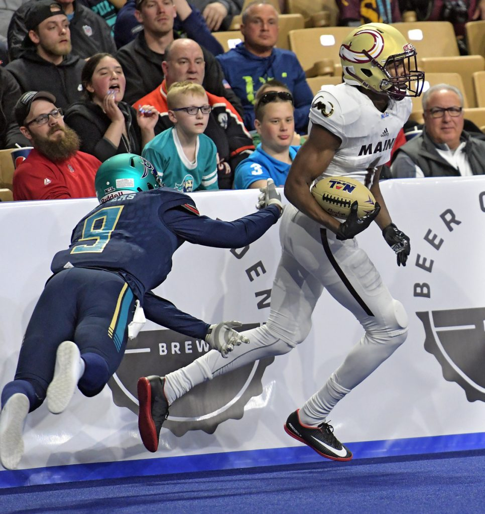 WORCESTER - Maine Mammoths Derrick Macon eludes the tackle attempt of Massachusetts Pirates' Troy Sanders at the DCU Center, during the Pirates' National Arena League home opener, Saturday, April 7, 2018. [T&G Staff/Steve Lanava]