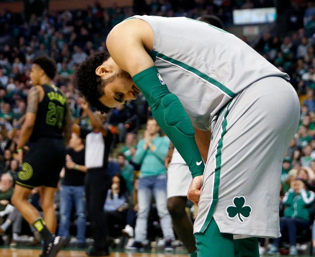 Shane Larkin of the Boston Celtics reacts Sunday after missing a layup in the final 10 seconds that would have pulled the team within two points of the Atlanta Hawks.