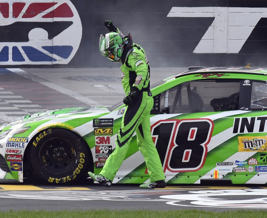 Kyle Busch celebrates after winning Sunday's NASCAR Cup Series race in Fort Worth, Texas. It was only the 10th race since his last victory, but he'd had a lot of close calls since.