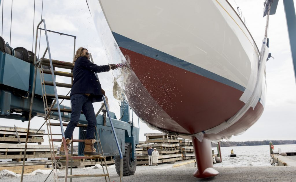 The latest completed project of Lyman-Morse Boatbuilding in Thomaston, a 65-foot sailing yacht named Anna, is christened before launch this month by the owner's wife.