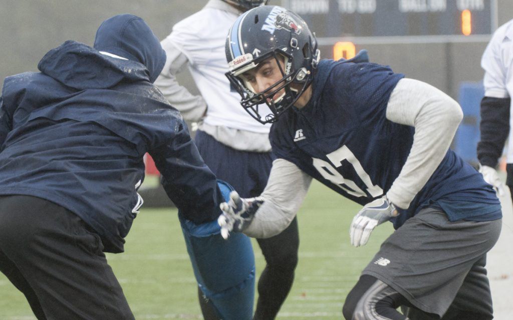 A graduate of Foxcroft Academy, Hunter Smith, right, is trying to earn playing time on the University of Maine football team. The Black Bears' coaching staff has made recruiting an in-state player like Smith a priority.