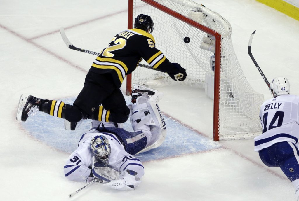 Bruins center Sean Kuraly scores against Toronto goaltender Frederik Andersen during the third period of Game 1 of their first-round playoff series Thursday in Boston. The Bruins won 5-1.