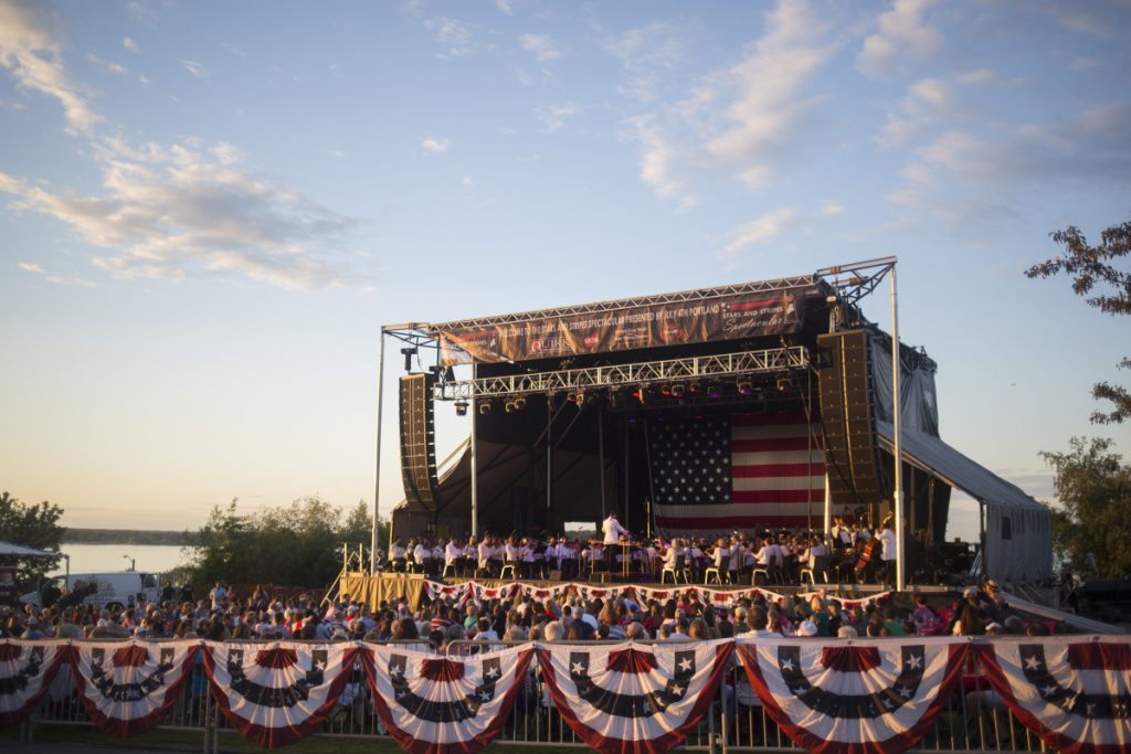 The Portland Symphony Orchestra plays at the Fourth of July celebration on the Eastern Promenade in Portland. The PSO won't be hired this year because of a lack of funds.