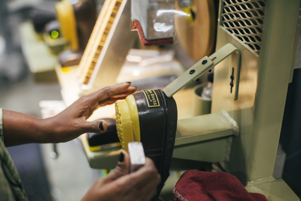 Yasmin Abdille places an L.L. Bean logo onto the back of the boots at their manufacturing facility in Brunswick in 2015.