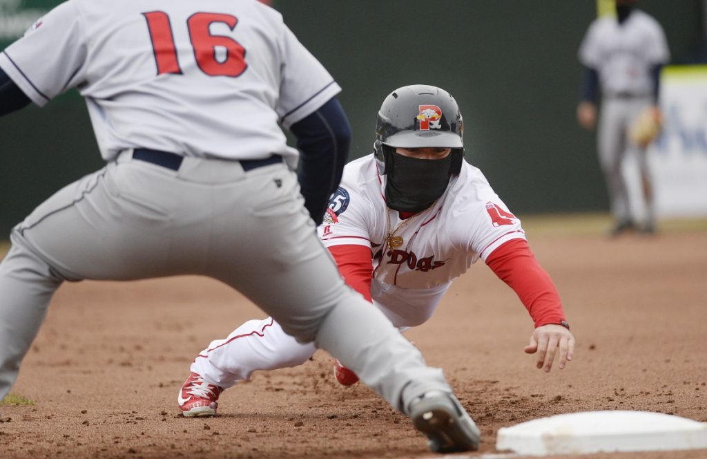 Portland's Esteban Quiroz dives back to first base on a pickoff attempt during Saturday's 3-0 win over the Binghamton Mets.