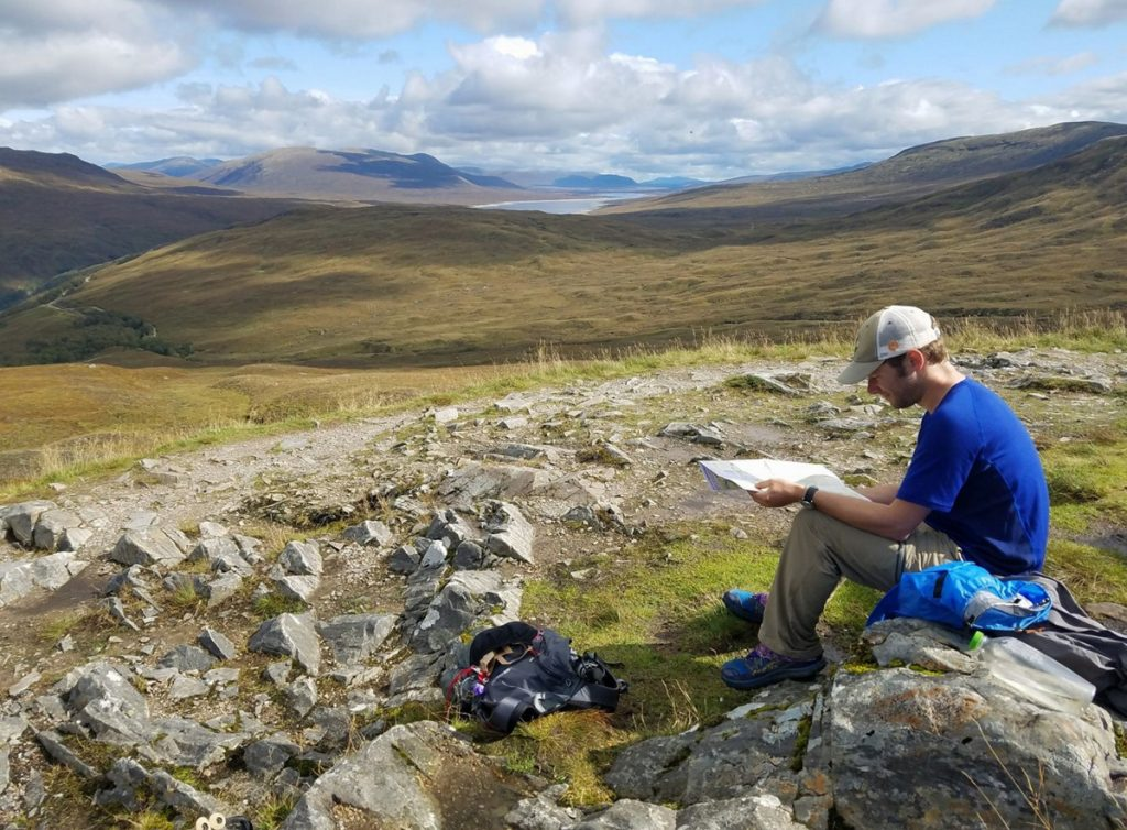 Ryan Linn grew up in Belfast, went to Vassar College and now lives in Portland, but he has also seen his share of the world. Shown here, he stops along a trail in Scotland to check his map in September.