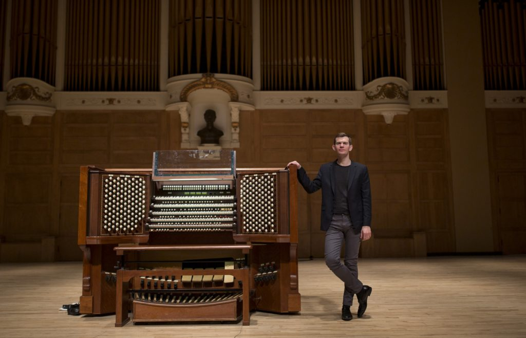 "James Kennerley, 33, will perform Wednesday for the first time since his selection as Portland's 11th municipal organist. As a boy growing up in England, he long aspired to come to America and play the Kotzschmar at Merrill Auditorium, built in 1912. Kennerley wants to bring people out of their homes, arenas and movie theaters and into the concert hall. ""This organ can do things those speakers could never do,"" he says."