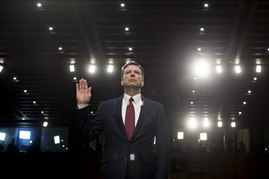 Former FBI director James Comey, above being sworn in at a Senate Intelligence Committee hearing in Washington in June 2017, details his discussions with President Trump in his new book.