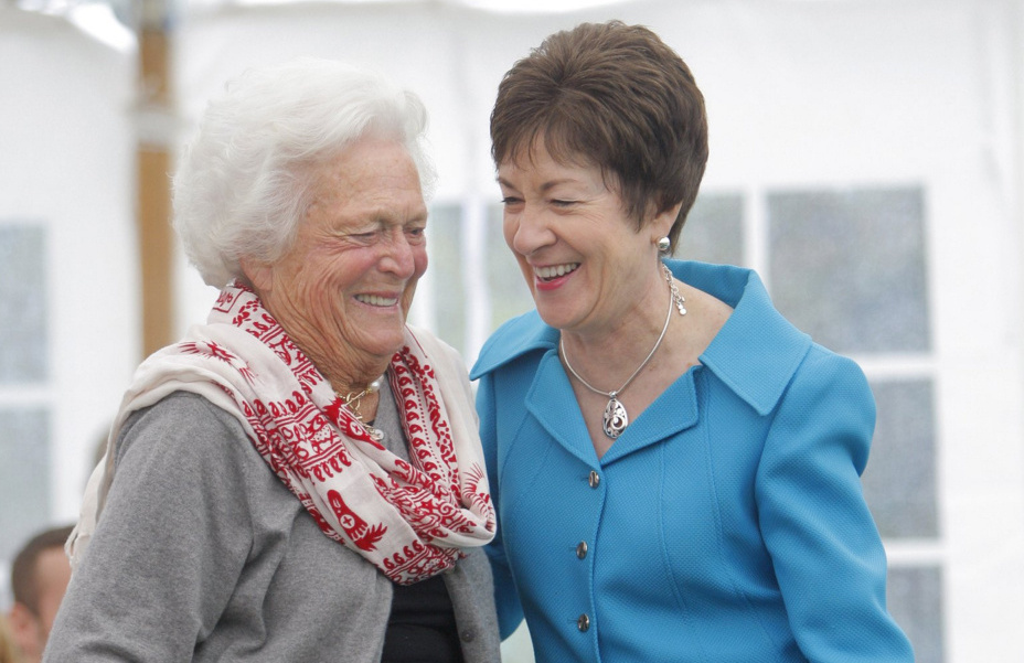 Barbara Bush and U.S. Sen. Susan Collins, R-Maine, share a laugh after the senator spoke at a dedication ceremony for a garden honoring Barbara Bush at the town green in Kennebunkport on Sept. 29, 2011.