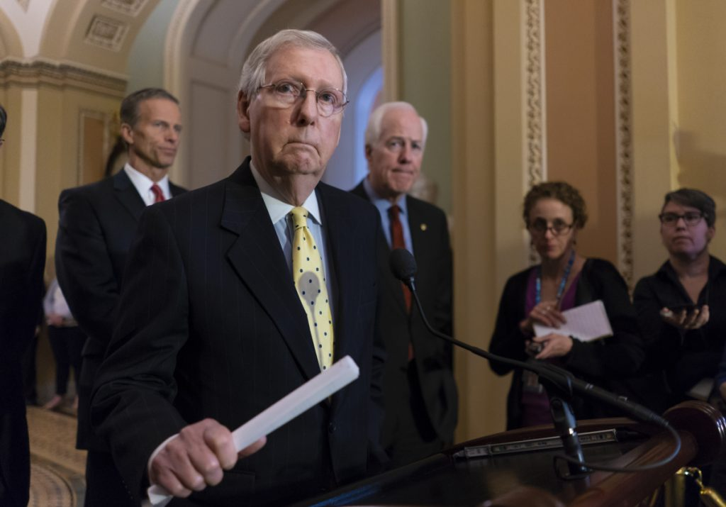 Sen. Mitch McConnell, R-Ky., joined from left by Sen. John Thune, R-S.D., and Majority Whip John Cornyn, R-Texas on Tuesday at the Capitol.