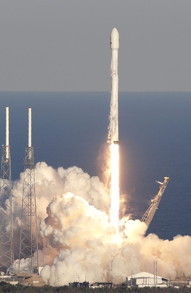 A SpaceX Falcon rocket transporting the Tess satellite lifts off Wednesday from Cape Canaveral.