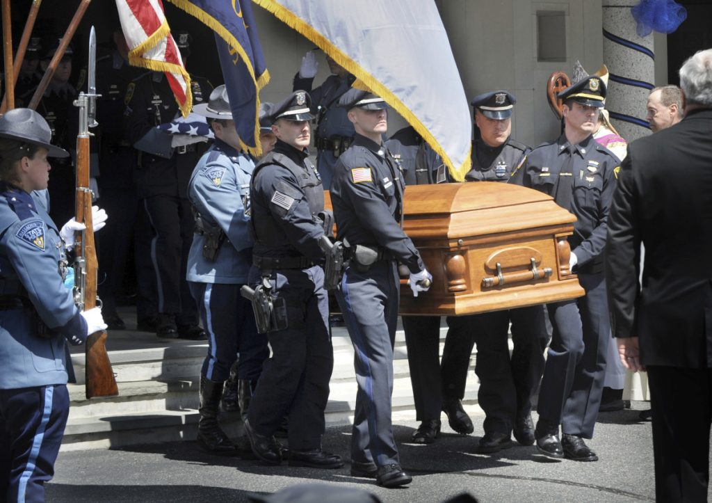 Police carry the coffin of K-9 Officer Sean Gannon after a funeral service Wednesday in Yarmouth, Mass.