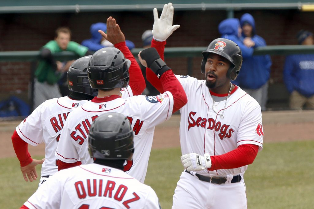 After Bobby Poyner got the Sea Dogs started with a scoreless inning Thursday, Josh Ockimey, right, delivered a grand slam and led Portland to a 5-0 victory against Hartford. Story, C3