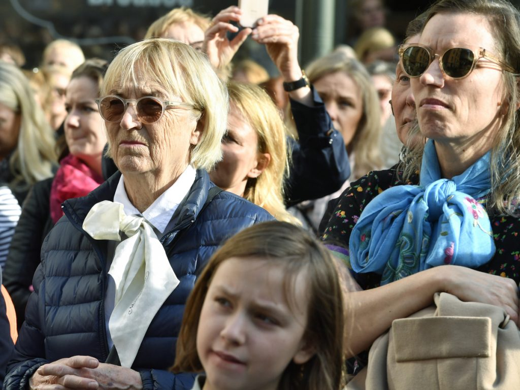 People gather outside the headquarters of the Swedish Academy in Stockholm to demand all of its remaining members resign Thursday.