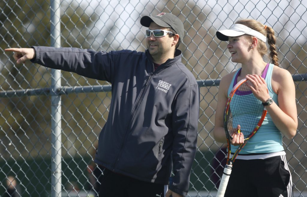 Greely Coach Ben Caswell chats at practice with senior Izzy Evans, who plays at No.1 singles for the Rangers.