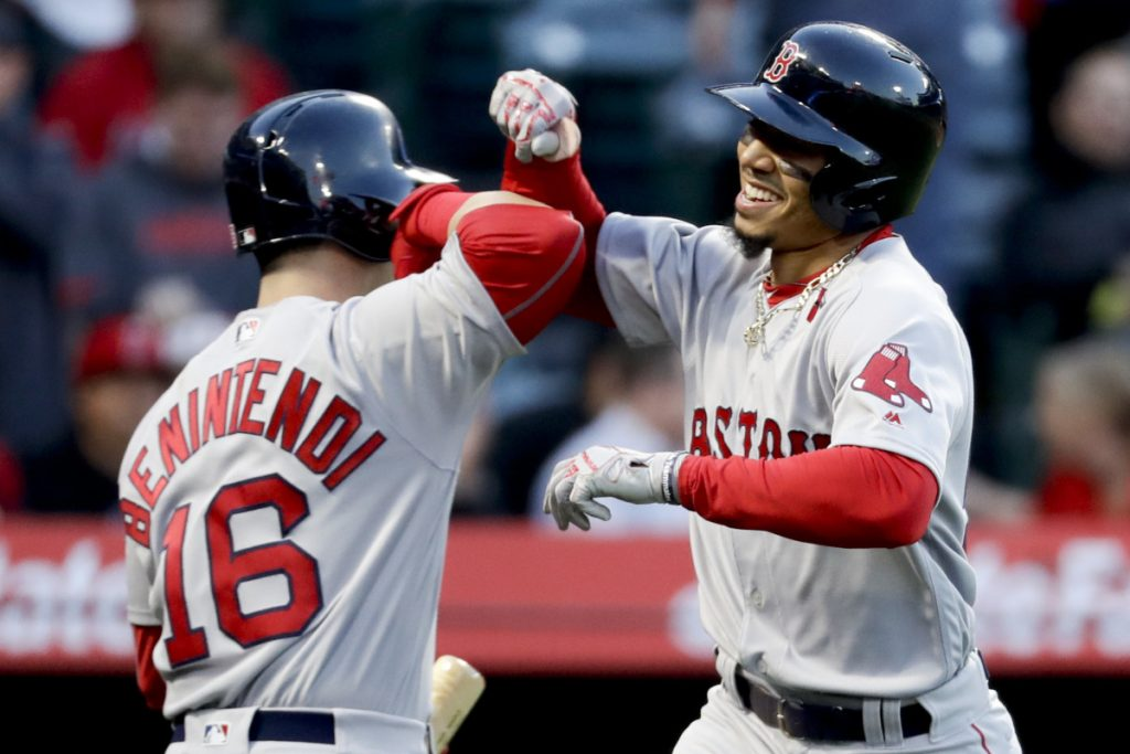Mookie Betts, right, and Andrew Benintendi have been consistently aggressive at the top of the batting order, and it's paid off for the Boston Red Sox, who not only are off to their best start but one of the best in baseball over the past half-century.