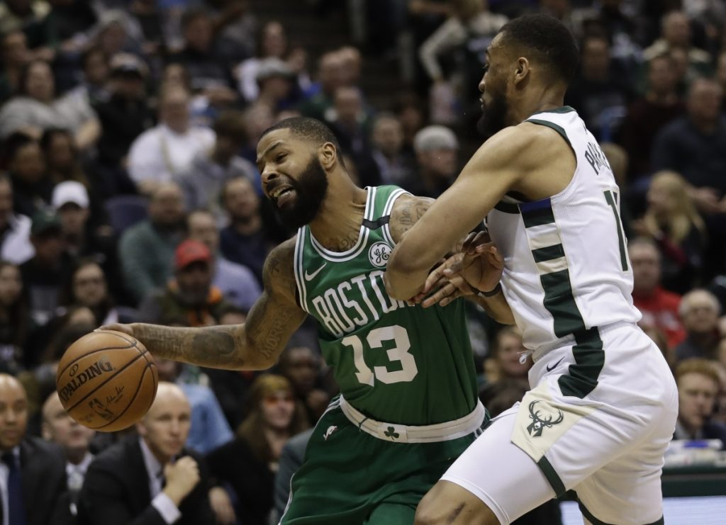 The Boston Celtics' Marcus Morris tries to drive past Milwaukee Bucks' Jabari Parker during the second half of Game 3 of their first-round playoff series Friday in Milwaukee. (AP Photo/Morry Gash)