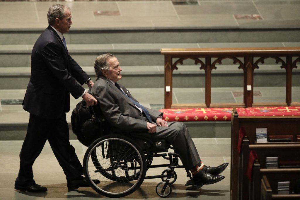 Former Presidents George W. Bush, left, and George H.W. Bush arrive at St. Martin's Episcopal Church on Saturday for the funeral of Barbara Bush. The elder Bush was hospitalized Sunday.