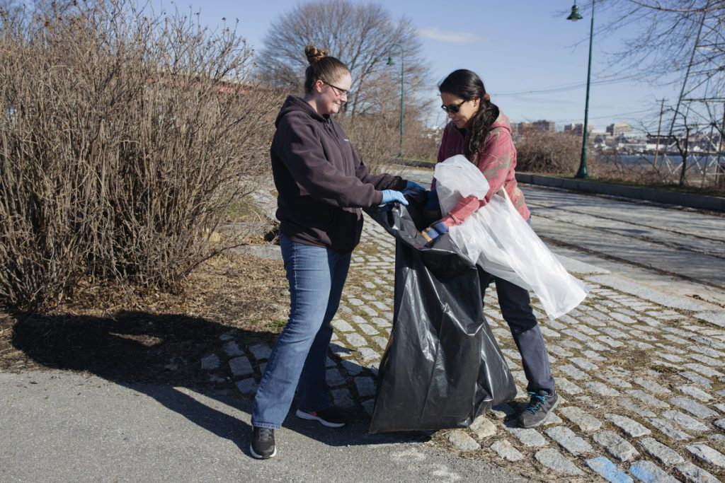 Nicole Malpass, left, of Gorham and Christine Bodnar of Standish pick up litter at Thomas Knight Park in South Portland on Saturday.