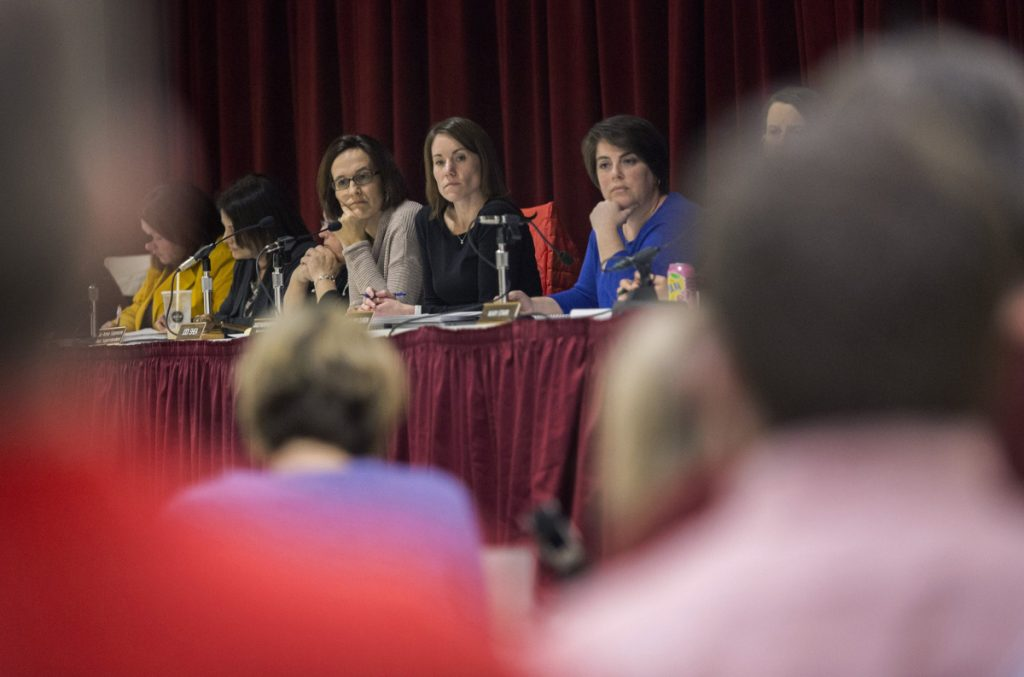 At a special meeting of the board of education last month, Scarborough Superintendent Julie Kukenberger, center, listens to arguments about changing school start times, one of the policy issues linked to a conflict between the superintendent and high school Principal David Creech.