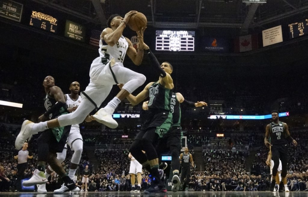 Milwaukee's Giannis Antetokounmpo drives past Boston's Jayson Tatum during Game 4 of their first round series on Sunday in Milwaukee. The Bucks won 104-102 to even the series at 2-2.