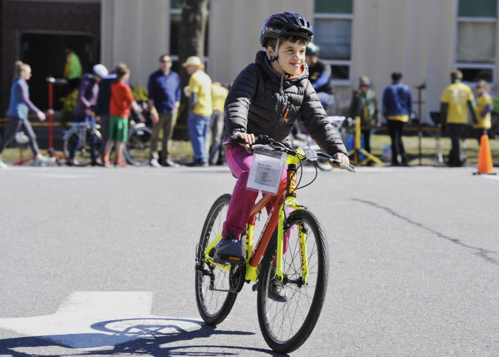 Ren Kauffunger, 9, of Arrowsic tests his bike of choice at the Bicycle Coalition of Maine's annual Great Maine Bike Swap held at the University of Southern Maine in Portland on Sunday.
