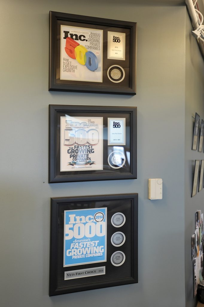 Fortune 500 awards from recent years hang on a wall of Portland-based Vets First Choice.